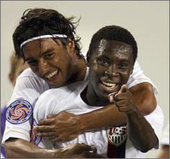 The USA's Freddy Adu, right, celebrates with teammate Kamani Hill after scoring in the CONCACAF soccer men's Olympic qualifier in Tampa. Adu's score was the only goal the USA could manage in tying Cuba 1-1.