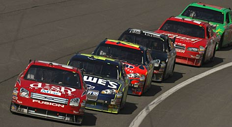 Carl Edwards' Ford leads a varied pack, including (in order) the Chevys of Jimmie Johnson and Jeff Gordon, Matt Kenseth's Ford, the Dodge of Kasey Kahne and Kyle Busch's Toyota.