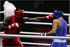"American boxer Deontay Wilder, left, fights China's Wang Leilei last year at the ""Good Luck Beijing"" International Boxing Invitational Tournament in Beijing. Like his daughter with spina bifida, Wilder is working on his own against-the-odds progression: from novice to Olympic boxer in less than three years."