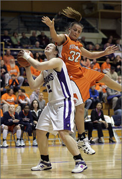 Bucknell's Laura Schober lands on the back of a Holy Cross player as the Bison earned their second  NCAA tournament berth.