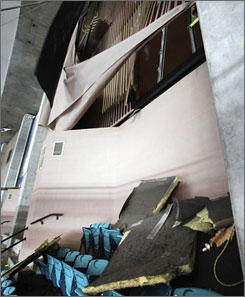 The upper-deck areas of the Georgia Dome had holes in the walls and debris on seats.