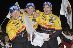 Penske Racing drivers (from left) Emmanuel Collard, Romain Dumas and Timo Bernhard celebrate a long-awaited Porsche victory at Sebring.