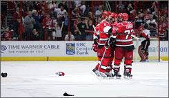 Carolina's Joe Corvo celebrates his third goal of the game with his teammates in the Hurricanes' 5-1 win over Ottawa on Sunday.
