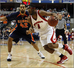 Marcus Landry goes to the hoop against Illinois defender Brian Randle during Wisconsin's victory.