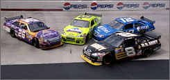 Aric Almirola (8) takes evasive action during a midrace stack-up involving (from left) Jamie McMurray, Paul Menard and Ryan Newman.
