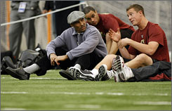 Quarterback Matt Ryan, right, talks with Kansas City Chiefs coach Herm Edwards during the pro day at Boston College on Tuesday.
