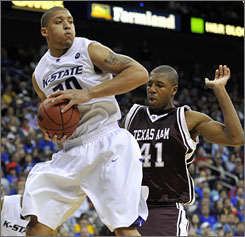 Star freshman Michael Beasley faces off with fellow freshman phenom O.J. Mayo when Kansas State and Southern Cal tipoff on Thursday night in Omaha.