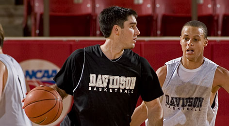 "Davidson's Stephen Curry, right, is averaging 25.1 points a game for the Wildcats, which is fifth-best in Division I. His teammate, point guard Jason Richards, is dishing out a national-best 8.0 assists a game. Both players' accomplishments have the Wildcats roaring into the tournament. ""We have a feel for each other when we're on the court, and that's something that's evolved over time,"" Richards said."