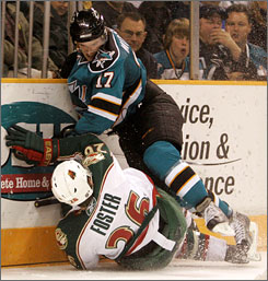 Minnesota Wild defenseman   Kurtis Foster, bottom, suffered a broken leg after colliding with San Jose Sharks center Torrey Mitchell in Wednesday's game in San Jose, Calif.