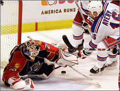 Florida Panthers goalie Tomas Vokoun stops the New York Rangers' Sean Avery in one of his four wins since he backed up usual backup Craig Anderson for three games.