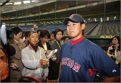 Boston's Daisuke Matsuzaka speaks to the media before the Red Sox's exhibition game against the Hanshin Tigers in Tokyo on Saturday.