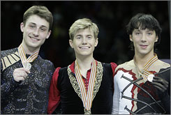 Jeffrey Buttle of Canada, center, took the gold medal at the World Figure Skating Championships with Brian Joubert of France, left, winning silver and the USA's Johnny Weir collecting the bronze.