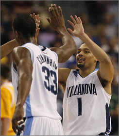 Scottie Reynolds celebrates with teammate Dante Cunningham during Villanova's second-round victory over Siena in Tampa.