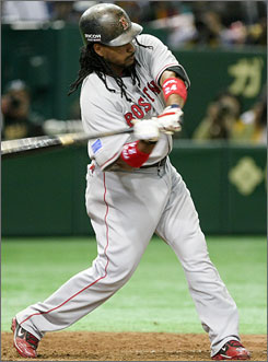 Manny Ramirez bangs a two-run double in the top of the 10th inning that made the difference in Boston's 6-5 victory over Oakland. The game in Tokyo opened the big-league season.