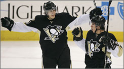 The Pittsburgh Penguins, who have Evgeni Malkin, left, and Sidney Crosby, are one of the few low-payroll teams that are thriving, but Crosby's pay will jump to $9 million next season and Malkin will get a big raise in 2009-10.