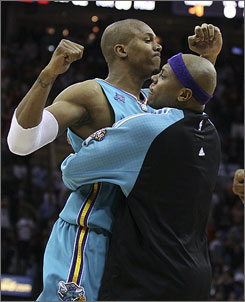 Hornets forward David West, left, receives a hug from teammate Bonzi Wells after sinking a 17-foot jumper with 0.6 seconds remaining to defeat the Cavaliers 100-99 at Quicken Loans Arena. West, whose jumper came moments after LeBron James gave the Cavaliers a 99-98 lead with 7.7 seconds left with a layup, finished with 20 points, six rebounds and four assists.