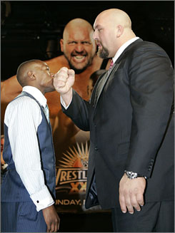 Wrestler Big Show, right (obviously), will square off against boxer Floyd Mayweather Jr. on Sunday. Big Show weighs 441, Mayweather 159.