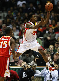 West guard Brandon Jennings shoots in front of the East's Kemba Walker during the McDonald's All-American game Wednesday.