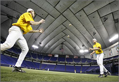 Players from St. Scholastica play a game of two-ball at 1:49 a.m. between a doubleheader.