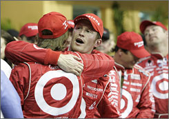 Scott Dixon, right, embraces teammate Dan Wheldon after winning the Gainsco Indy 300. Dixon lost the IRL IndyCar Series title last year when he ran out of fuel on the last lap of the season.