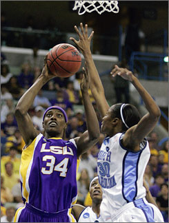 LSU center Sylvia Fowles, left, shoots over North Carolina's LaToya Pringle in the second half of the New Orleans Regional final on Monday. LSU defeated the Tar Heels 56-50 to earn their fifth straight trip to the Final Four.