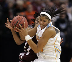 Despite dislocating her left shoulder in the first half, Tennessee swingman Candace Parker scored 26 points to lead the Volunteers to a 53-45 win over Texas A&M to advance to the Final Four.