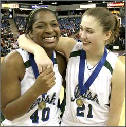 Ki-shawna Moore, left, and Ashley Boggs celebrate Sacred Heart Cathedral's CIF Division III title.