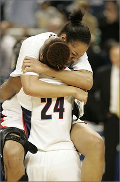 Connecticut forward Charde Houston holds up teammate Brittany Hunter following the Huskies' 66-56 win over Rutgers to advance to the Final Four