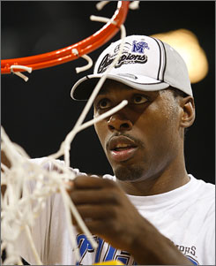 Memphis' Joey Dorsey cuts off his piece of the net after the Tigers upended Texas to win the South Region. But can Dorsey and the Tigers do enough to take home the national title in San Antonio?