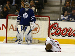 Ottawa's Daniel Alfredsson lies on the ice after taking a hit during the Senators' win over Toronto on Thursday night. If the Senators qualify for the postseason, Alfredsson may miss some early games.