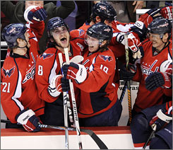 From left, Brooks Laich, Alexander Ovechkin and Nicklas Backstrom celebrate with teammates after the Capitals clinched their first playoff berth since 2003.