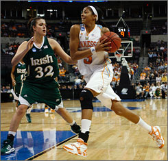 Candace Parker drives to the basket during an NCAA Tournament win over Notre Dame on Monday. Parker averaged 21.6 points and 8.3 rebounds this season on her way to winning national player of the year honors.