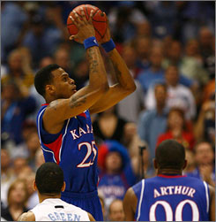 Brandon Rush stepped up to lead Kansas past North Carolina and into the national title game for the first time since 2003.