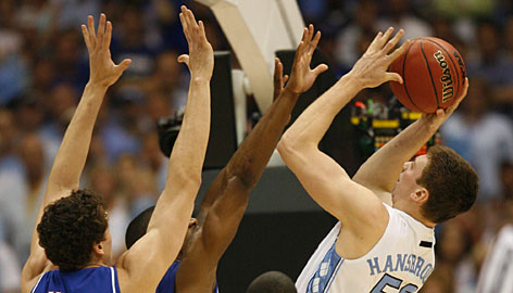 Tyler Hansbrough looks to get off a shot as Kansas' Darrell Arthur, behind, Sasha Kaun, left, and Mario Chalmers defend in the second half of the Jayhawks' semifinal victory.