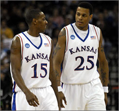 Kansas' Mario Chalmers and Brandon Rush are two of the Jayhawks' four sensational guards that hope to make it tough for Memphis' dynamic duo  Chris Douglas-Roberts and Derrick Rose  to get going in Monday night's title game.