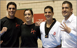 The Lopez siblings, from left, Steven, Diana, Mark and Jean Lopez, pose for a picture backstage at the Olympic Taekwondo Trials. Under Jean's coaching, Steven, Diana and Mark all made the U.S. Olympic team, becoming the first family of three to qualify for the Olympics since 1904.