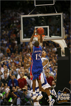 Mario Chalmers launches the game-tying shot with 2.1 seconds left in regulation, forcing the national title game into overtime. The Kansas guard, named most outstanding player in the Final Four, finished with 18 points and four steals.