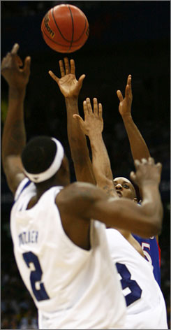 Kansas guard Mario Chalmers fires the three-pointer that sent Monday's title game against Memphis into overtime.