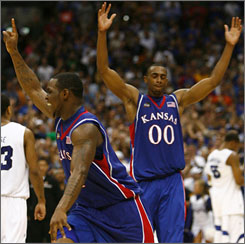 Sherron Collins, left, and Darrell Arthur celebrate the third national championship in Kansas history and the Jayhawks' first since 1988.
