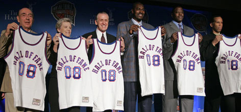 Inductees (from left) Dick Vitale, Cathy Rush, Pat Riley, Hakeem Olajuwon, Patrick Ewing and Adrian Dantley display their ceremonial jerseys as members of the Basketball Hall of Fame's 2008 class.