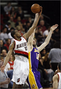 Trail Blazers forward  LaMarcus Aldridge, left, wins a jump ball against Lakers counterpart  Pau Gasol in the first quarter of Portland's 112-103 home victory over Los Angeles. Aldridge finished with 22 points and 16 rebounds.