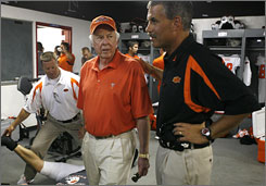 Billionaire oilman and investor T. Boone Pickens talks with Oklahoma State linebackers coach Todd Bradford in the locker room before the game against Georgia last season.