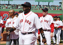 David Ortiz, center, and Curt Schilling, near right, are among the Red Sox players who received their World Series championship rings during a ceremony before Tuesday's home opener at Fenway Park.