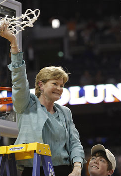 Tennessee coach Pat Summitt waves to the crowd after cutting down the net after the Lady Vols triumphed in Tampa. Summitt and Co. avenged a 73-69 overtime loss to Stanford back on Dec. 22 for their eighth national championship.