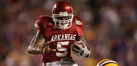 "Arkansas running back Darren McFadden could be a top pick in the NFL draft. ""Adrian Peterson's success this past year will make people look at Darren McFadden in a different light,"" says Ravens director of college scouting Eric DeCosta."