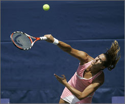 Amelie Mauresmo serves to Agnieszka Radwanska during their third-round match at the Bausch & Lomb Championships on Thursday. Mauresmo earned her 500th career win with the 3-6, 7-5, 7-6 (8-6) win on Amelia Island, Fla.