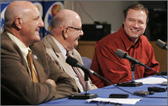 Kansas basketball coach Bill Self, right, appears at a news conference with athletic director Lew Perkins, left, and Chancellor Robert Hemenway in Lawrence, Kan., on Thursday. Three days after the Jayhawks won the national championship, Self announced that he had agreed to a lucrative contract extension that would keep him at Kansas.