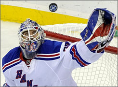 Rangers goaltender Henrik Lundqvist gloves the puck in Game 2 against the Devils in Newark. New York beat New Jersey 2-1 to take a 2-0 lead in the series.