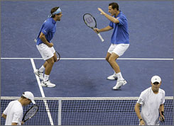 France stayed alive in the Davis Cup quarterfinals when Michael Llodra, top right, and doubles partner Arnaud Clement beat the USA's Bryan brothers.