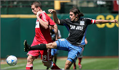 San Jose's Nick Garcia, right, defends against the Chicago Fire's Chad Barrett in the first half of their game in Oakland. Barrett scored the only goal to spoil the Earthquakes' home debut.